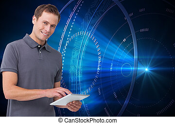 Composite image of smiling young man with tablet computer...