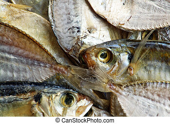 Salted Dried Fish - A close up image of small salted, dried...