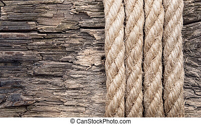very old wooden background with rope