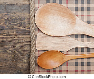 kitchen tools on vintage wooden background.