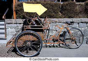 Cycle rickshaw in the street. , old and yellow park in the...