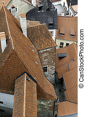 Roof shingles - Detail of orange roof shingles at old...
