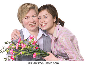 mothers day - mother receives a bunch of flowers from her...