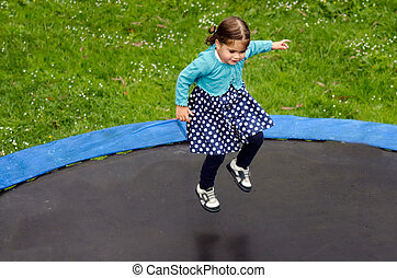 Girl jumps on trampoline - AUCKLAND OCT 08:GirlTalya Ben-Ari...