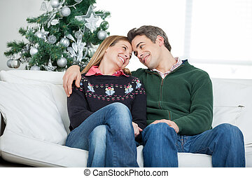 Romantic Couple Looking At Each Other During Christmas