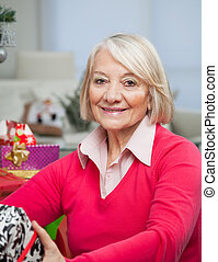 Senior Woman With Christmas Gift