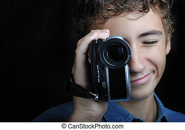 Filming - Young boy looking through a hand holding camera