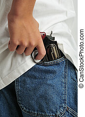 Alertness - Close up of a revolver holded in jeans back...