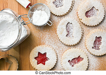 jelly christmas cookies with icing sugar - top view of jelly...