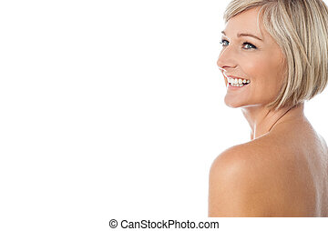 Smiling nude woman looking away - Middle aged female model...