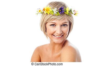 Beautiful woman wearing flower wreath - Attractive smilling...