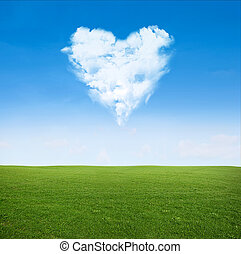 field clouds in shape of heart - green grass field and blue...
