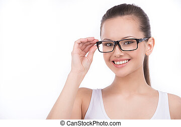 Beauty in glasses. Beautiful young woman in glasses looking...