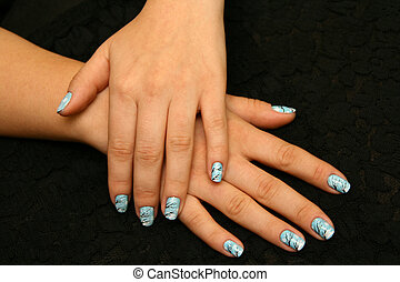 Manicure - Womans hands with winter manicure