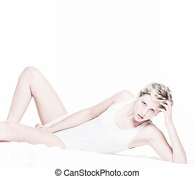 androgynous sexy woman in bed on white background