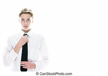 young androgynous woman correcting her tie - young...