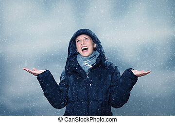 young woman is excited about the snowfall