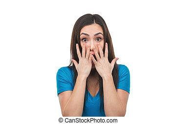 Terrified woman. Shocked young woman covering her mouth with hands and looking at camera while isolated on white