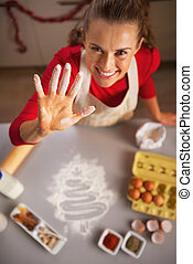 Closeup on happy young housewife showing hand stained in...