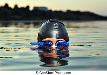 Swimming - Close up of young boy swimming in sea