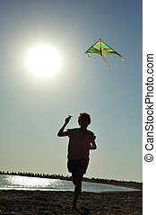 Kite flying - Boy running and flying a kite