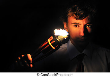 Flaming torch - Young businessman lighting with torch in...