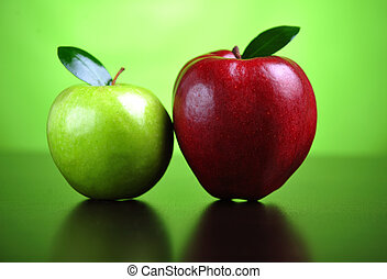 Green and red apples - A green and a red apple on a table