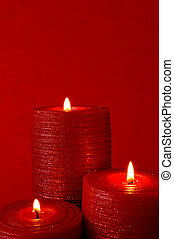 Christmas candle - Three burning red candles on red...