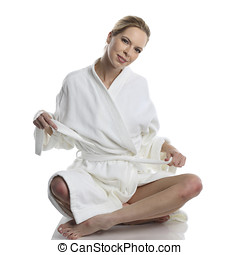 woman in white bathrobe - very beautiful woman dressed in a...