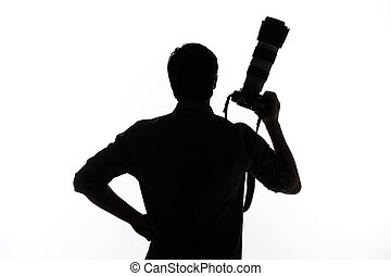 Man with camera. Silhouette of man holding camera and...