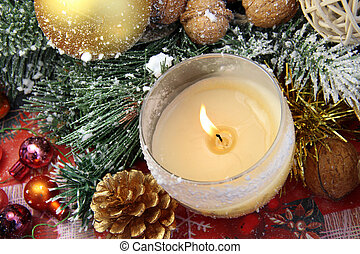 Beautiful Christmas decorations with burning candle -...