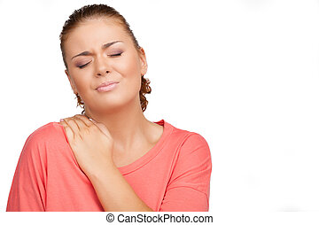 Pain in shoulder Depressed young woman touching her shoulder...