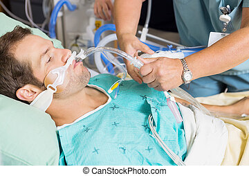 Nurse Adjusting Endotracheal Tube In Patients Mouth - Nurse...