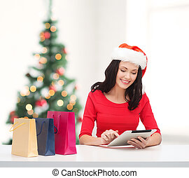 woman with shopping bags and tablet pc computer - christmas,...