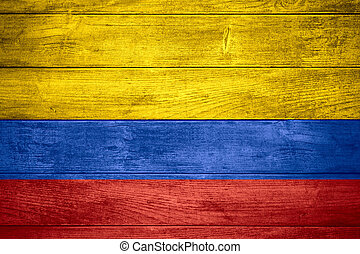 flag of Colombia or Colombian banner on wooden background