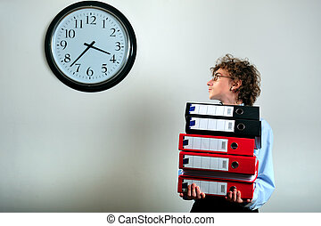 Deadline - Young businessman holding stack of folders and...