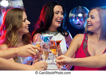 "three smiling women with cocktails in club - ""new year"",..."