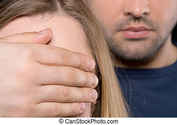 Close up of man and woman. Man closing female yes with his...