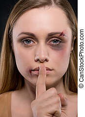 Close up of whipped blond female. Holding her finger,...