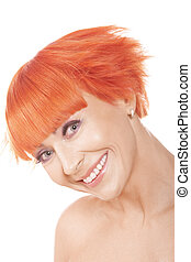 Smiling widely redhead woman over white background
