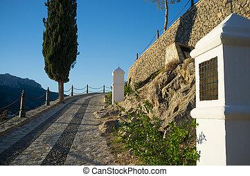 Calvary - Traditional calvary winding uplill towards a...