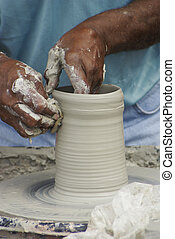 Potters Wheel 2 - A potter forms a vase during Mumfest in...