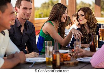 Cute female friends gossiping