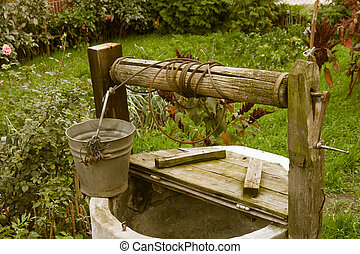Old rotten water well in garden