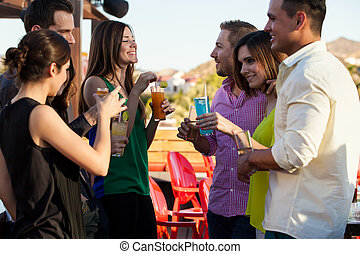 Group of friends having drinks - Group of young adults...