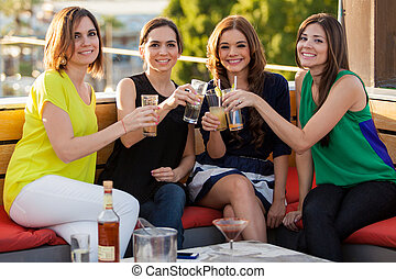 Beautiful female friends drinking - Group of four female...