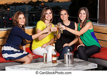 Female friends giving a toast