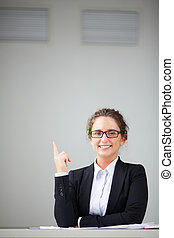 Pointing upwards - Image of attractive businesswoman in...