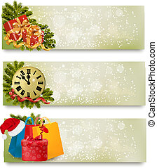 Three christmas banners with gift boxes and snowflake Vector...