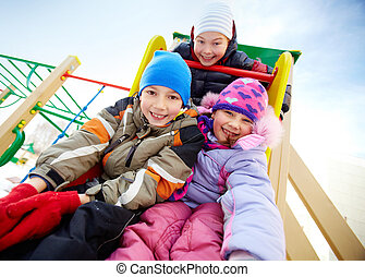 Playful friends - Happy friends having fun on playground in...